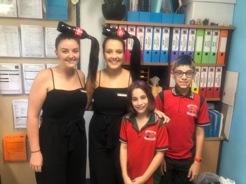 Northview State School staff members Emma Johnson and Marie Jansen with year five students Inara Sehl and Tydan Sehl with their crazy hair for Harmony Day.