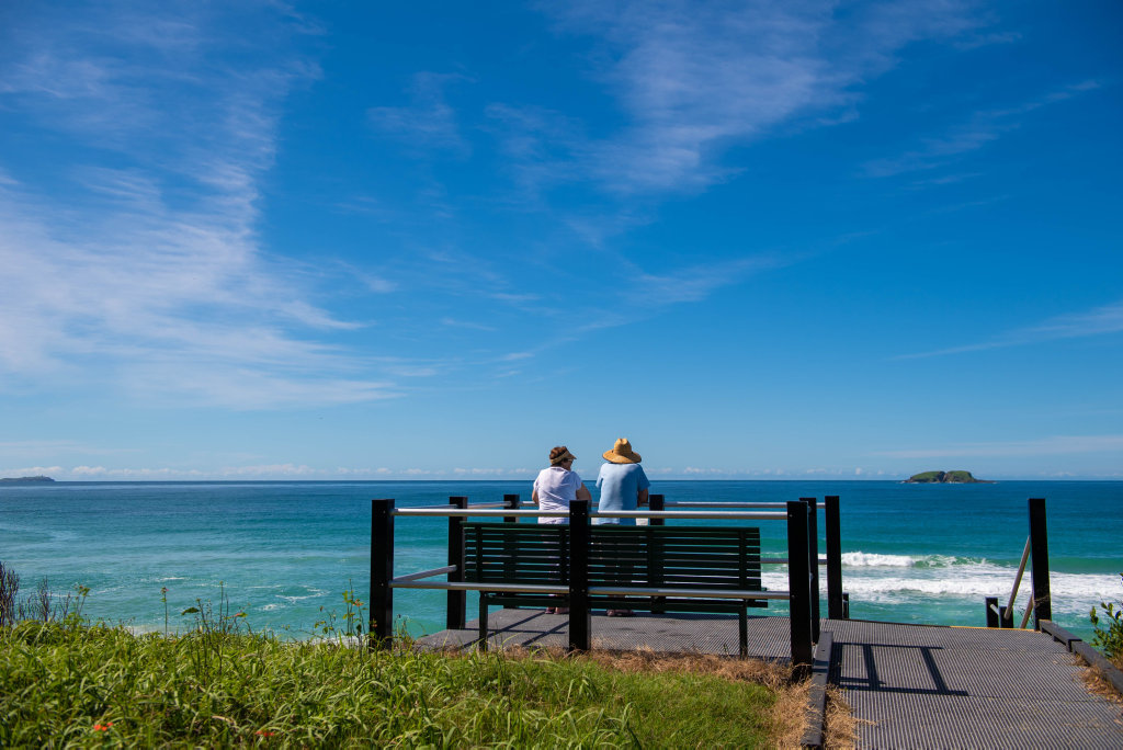 Image for sale: Two people only. A couple look out on a whole new world at Saphire Beach lookout. 30 MAR 2020