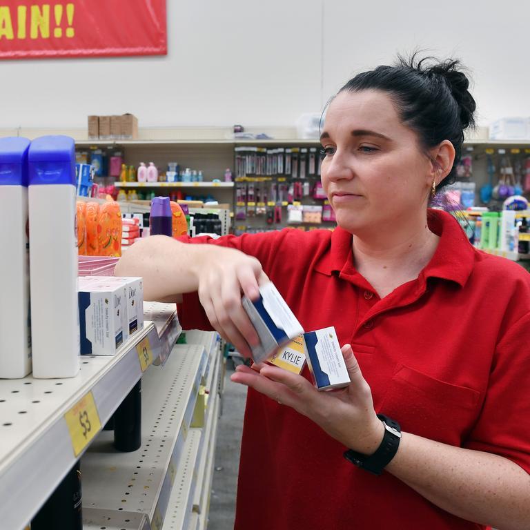 Mackay Silly Solly's store manager Kylie Darko restocks some shelves. Photo: Tony Martin