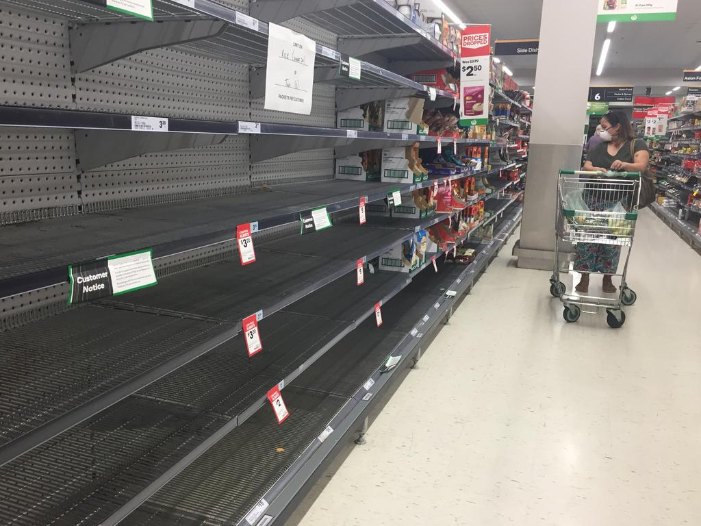 Shoppers at Woolworths stores have found shelves bare. Picture: John Gass
