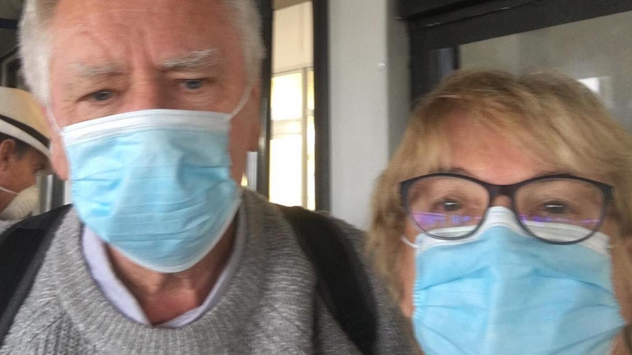 Grafton couple Ross and Karen McGarvie on their way to the airport in Rome after disembarking the Costa Victoria in Italy on Sunday. The couple have been flown back to Australia where they will be in lockdown in Western Australia for the next two weeks.