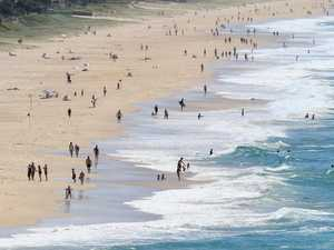 Beachgoers ignore calls to stay home