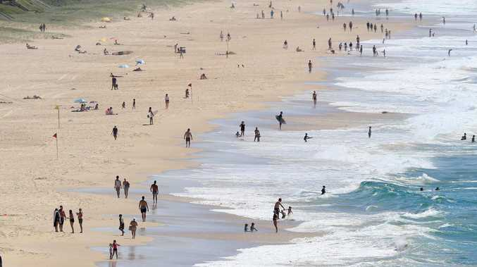 Gold Coast beachgoers ignore calls to stay home