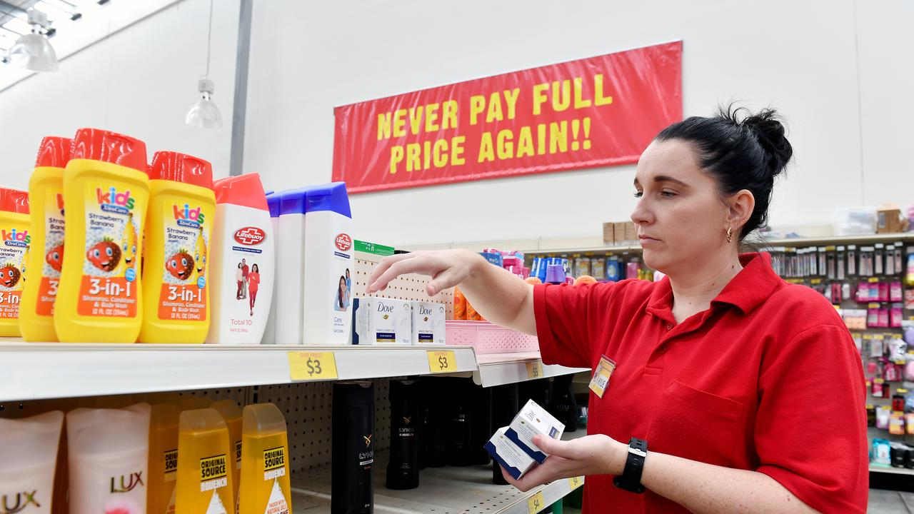 Mackay Silly Solly's store manager Kylie Darko restocks some shelves. Picture: Tony Martin