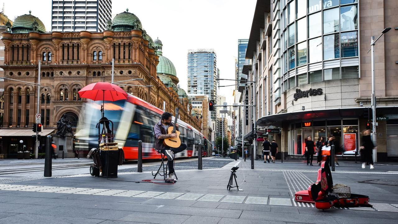 Only a busker and a few others dare battle the conditions. Picture: Mark Kriedemann/The Comma