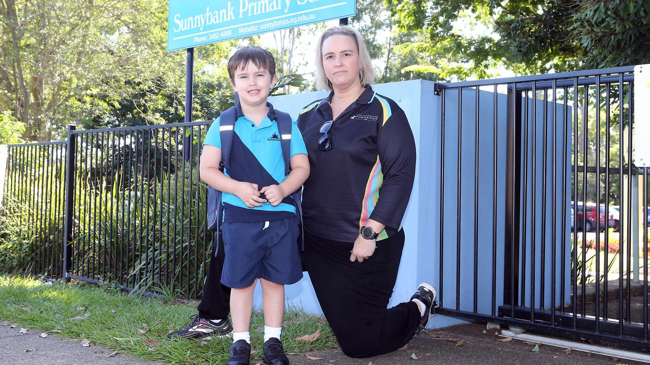 Dana Vukovic and her son Lex Lutherborrow at Sunnybank State School. Picture: AAP Image/Richard Gosling