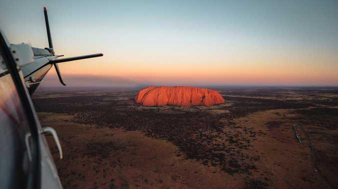 Race to track Uluru flights behind multiple national cases