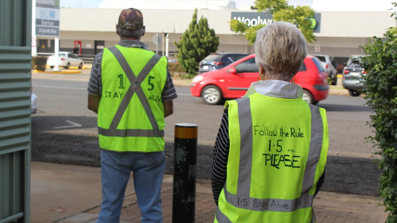 TAKING ACTION: Concerned community members Graham Rattledge and Pauline Shaw in their vests, which aim to create awareness about social distancing in public places. Photo: Laura Blackmore