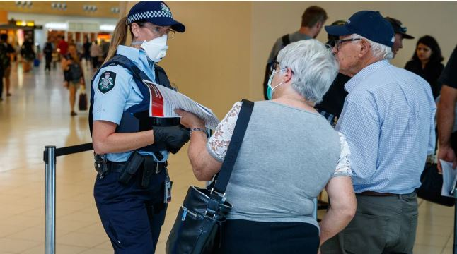 Passengers on the last flight into Adelaide Airport before the South Australian borders were shut in response to the COVID-19 outbreak.