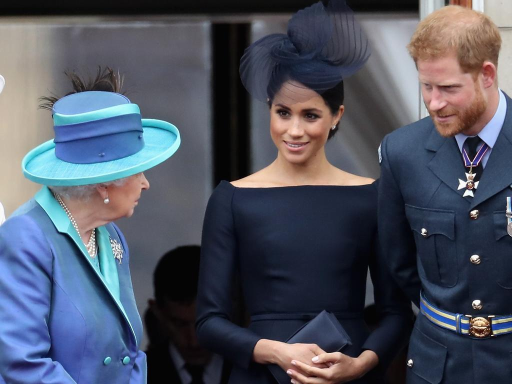 Once were royals ... the Queen with Meghan Markle and Prince Harry in 2018. Picture: Getty
