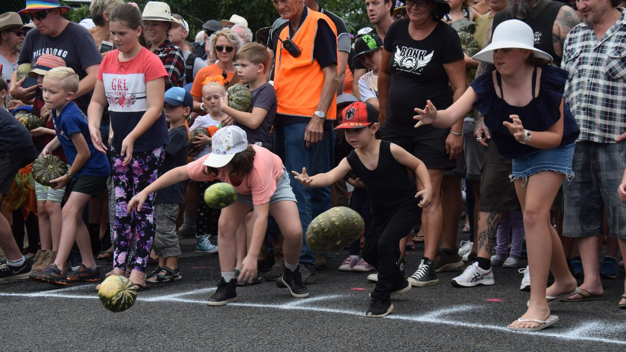 Competitors lining up for the famous pumpkin roll at last year's Goomeri Pumpkin Festival. Photo: File