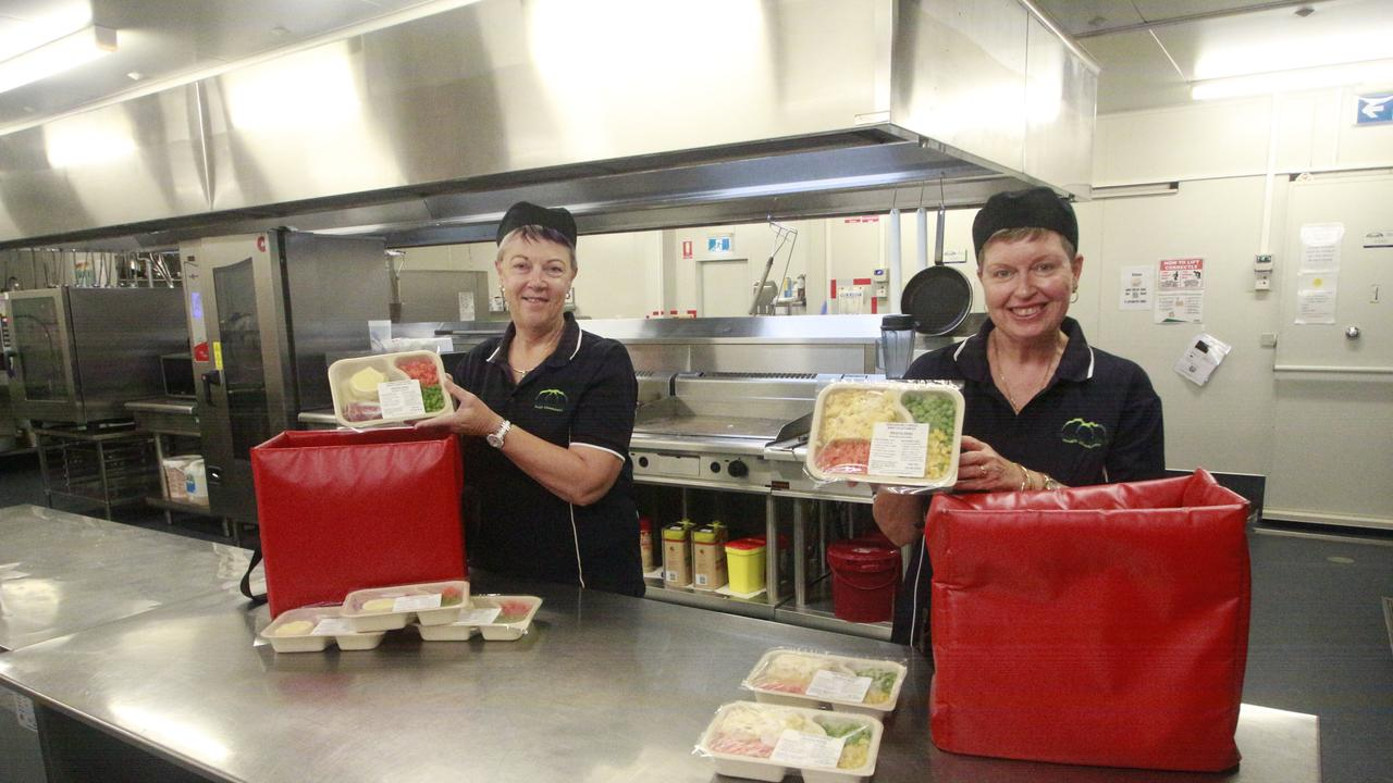 NEED HELP: Meals on Wheels Fraser Community Assistant Manager Colleen Spring and Accounts Manager Kim Parsons were packing meals for clients in the region.