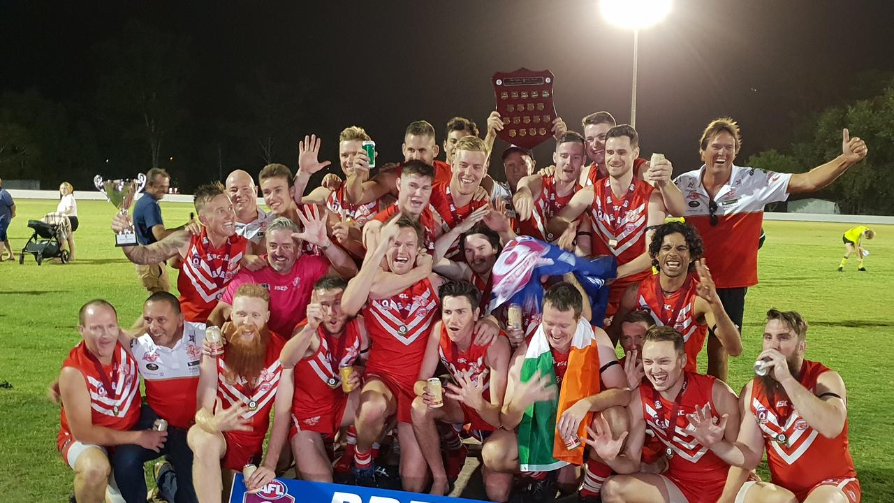 PREMIERS: The Yeppoon Swans celebrate their record fifth-straight AFL Capricornia flag win at Rockhampton Cricket Grounds on Saturday night.