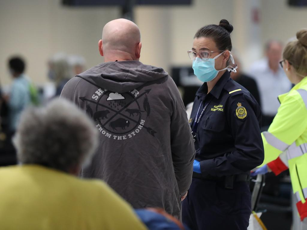 Australian Border Force officers talk with New Zealand passengers from the Vasco da Gama cruise ship in Perth. Picture: Getty