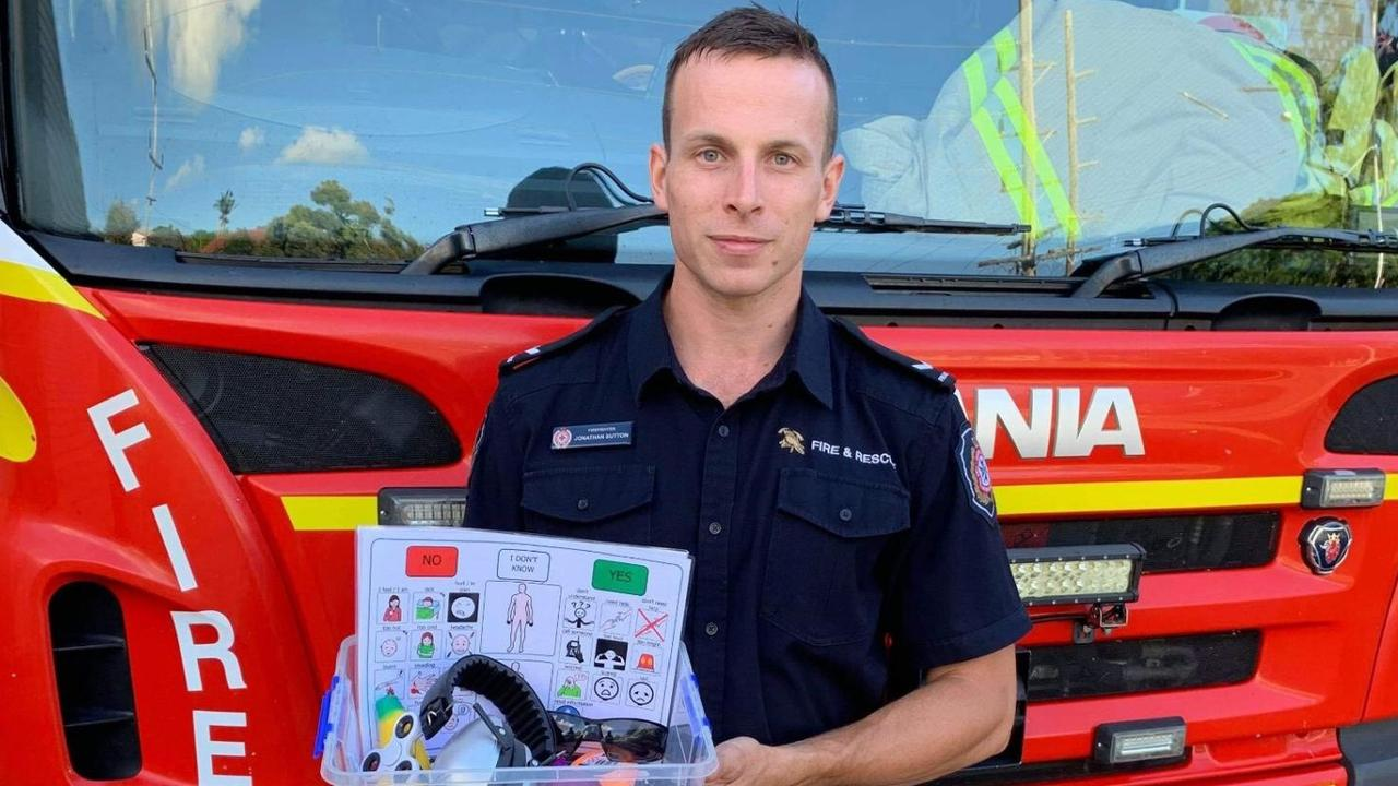 Gladstone Fire and Rescue Station firefighter Jonathan Sutton with an autism sensory trauma kit which aims to help firefighters communicate with individuals with autism or communication difficulties.