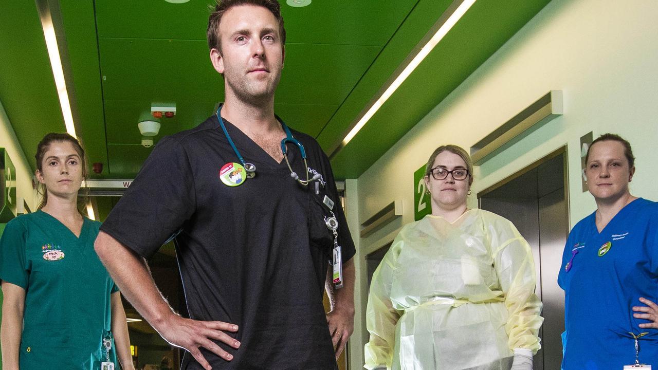 Queensland Children's Hospital staff (from left) registered nurse Maja Mills, infection control nurse Kate Williams, emergency doctor Simon Potter and nurse Lauren Bhandari. Picture: Nigel Hallett