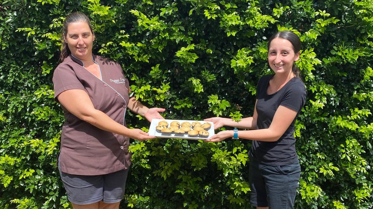 LET THEM EAT CAKE: Staff members Emily Nevin and Zoe Thompson practising social distancing with the cupcakes, at Paisley Park in Bundaberg.