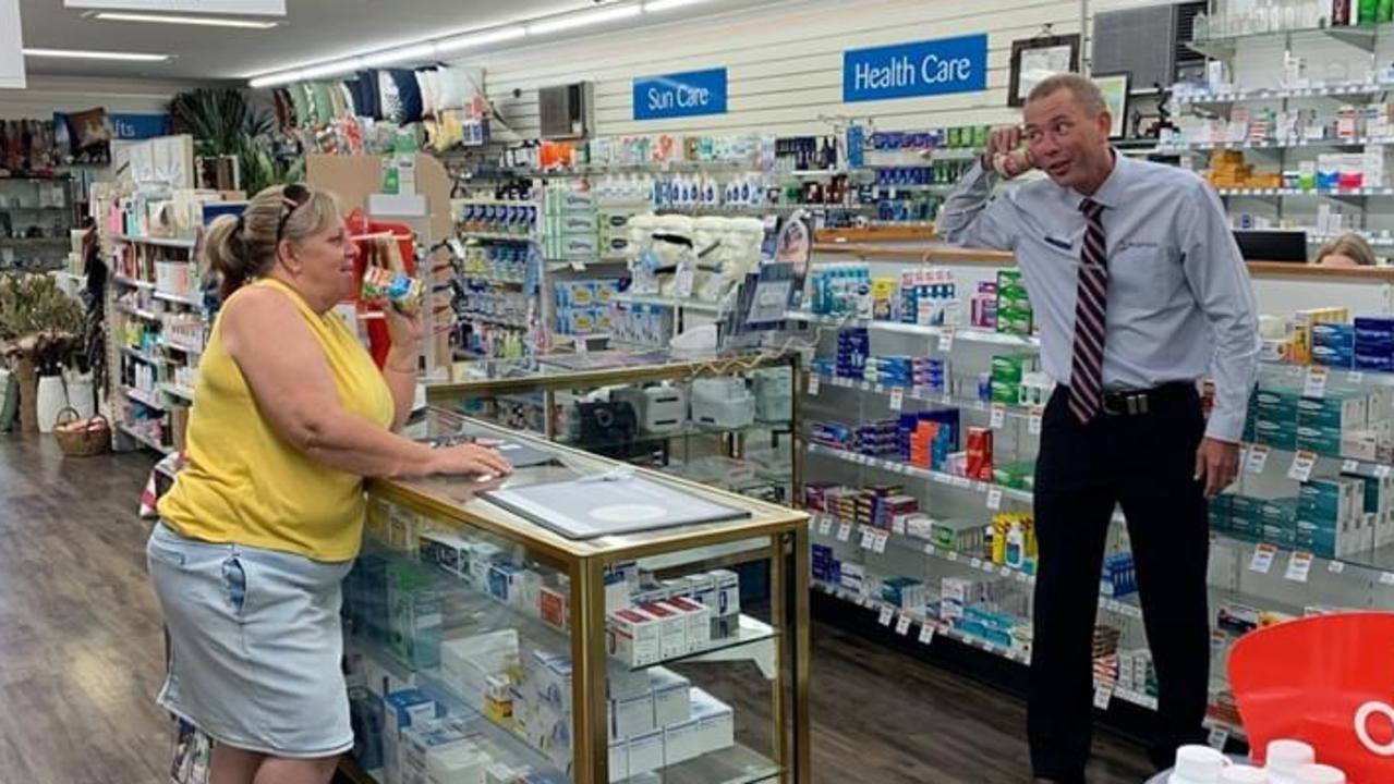 Clermont Pharmacy owner Grant Oswald with one of his customers.