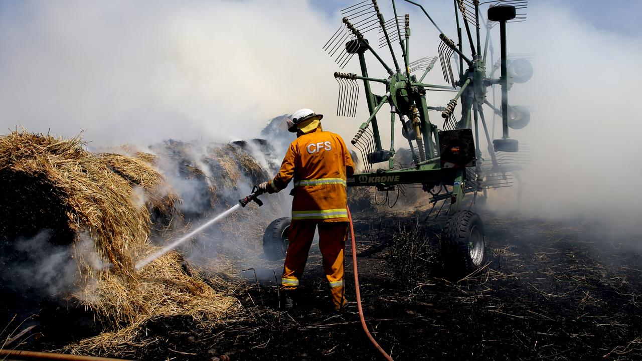 CFS members put out a fire at Mount Torrens in the Adelaide Hills. Picture: AAP / Kelly Barnes
