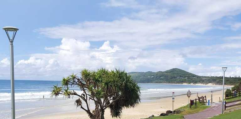 RARE SCENE: An empty main beach at Byron Bay on Sunday as people take social -distancing rules seriously.