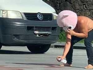 Masked man accused of violence toward paramedic, graffiti