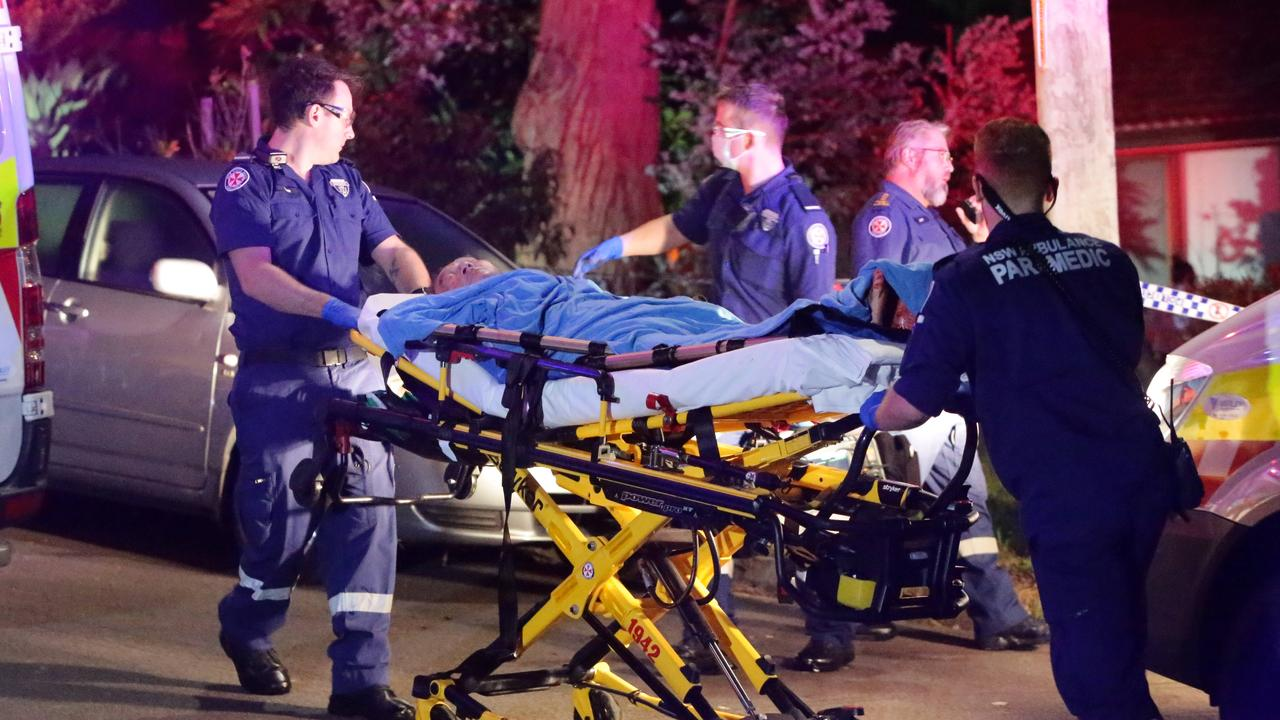 Paramedics rush one of the injured to hospital. Picture: Bill Hearne