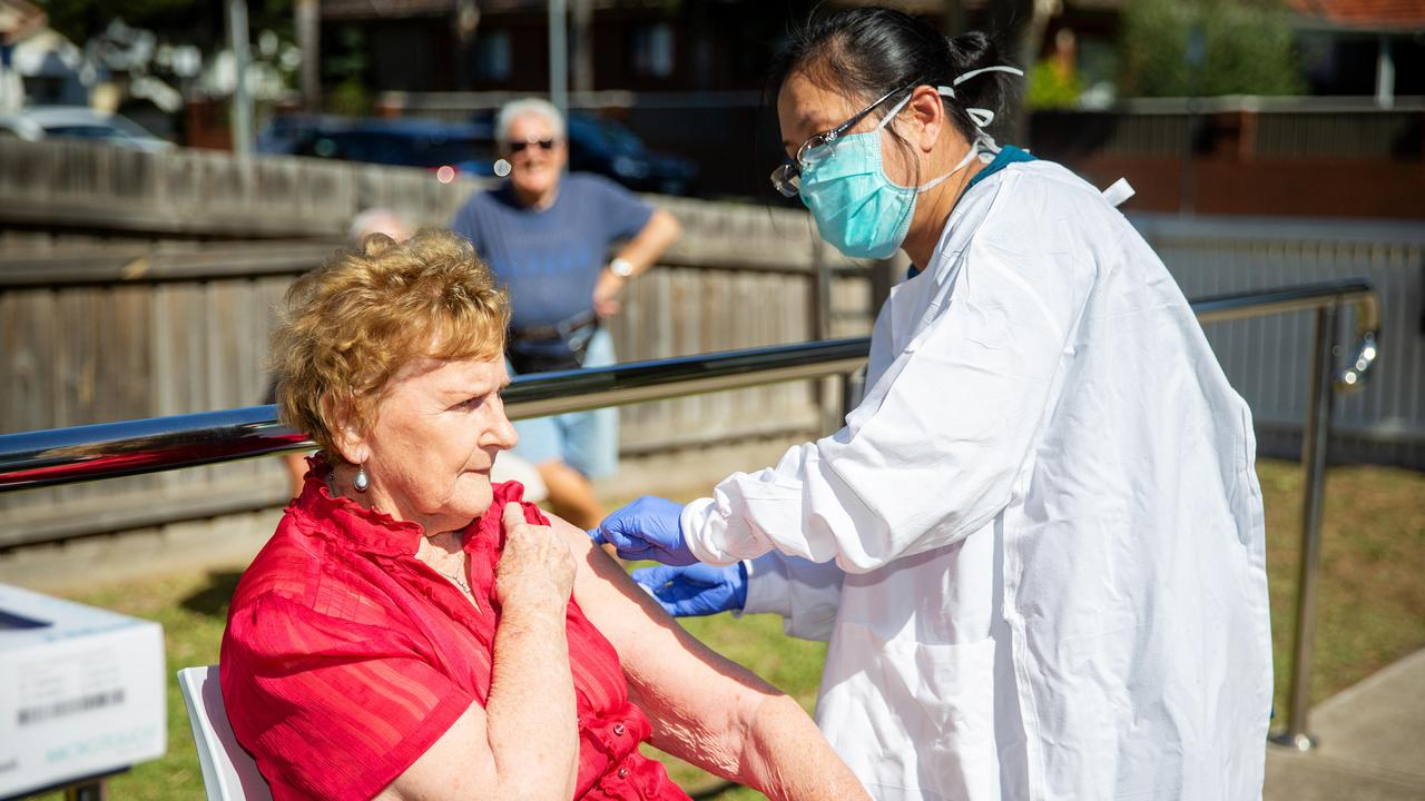 Nurse Phuong Vo gives Joyce Jardine, 88, her vaccination in Newport. Picture: Mark Stewart
