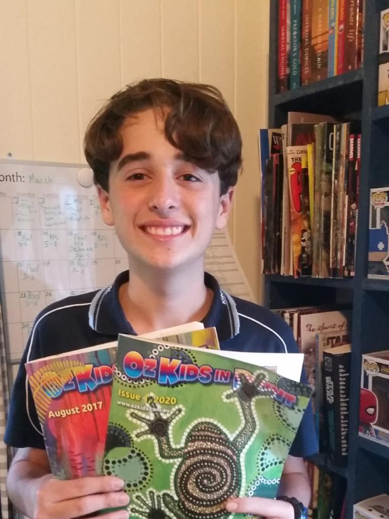 PUBLISHED POET: Ben Springhall holding the edition of OzKids with his poem. Photo: St John's