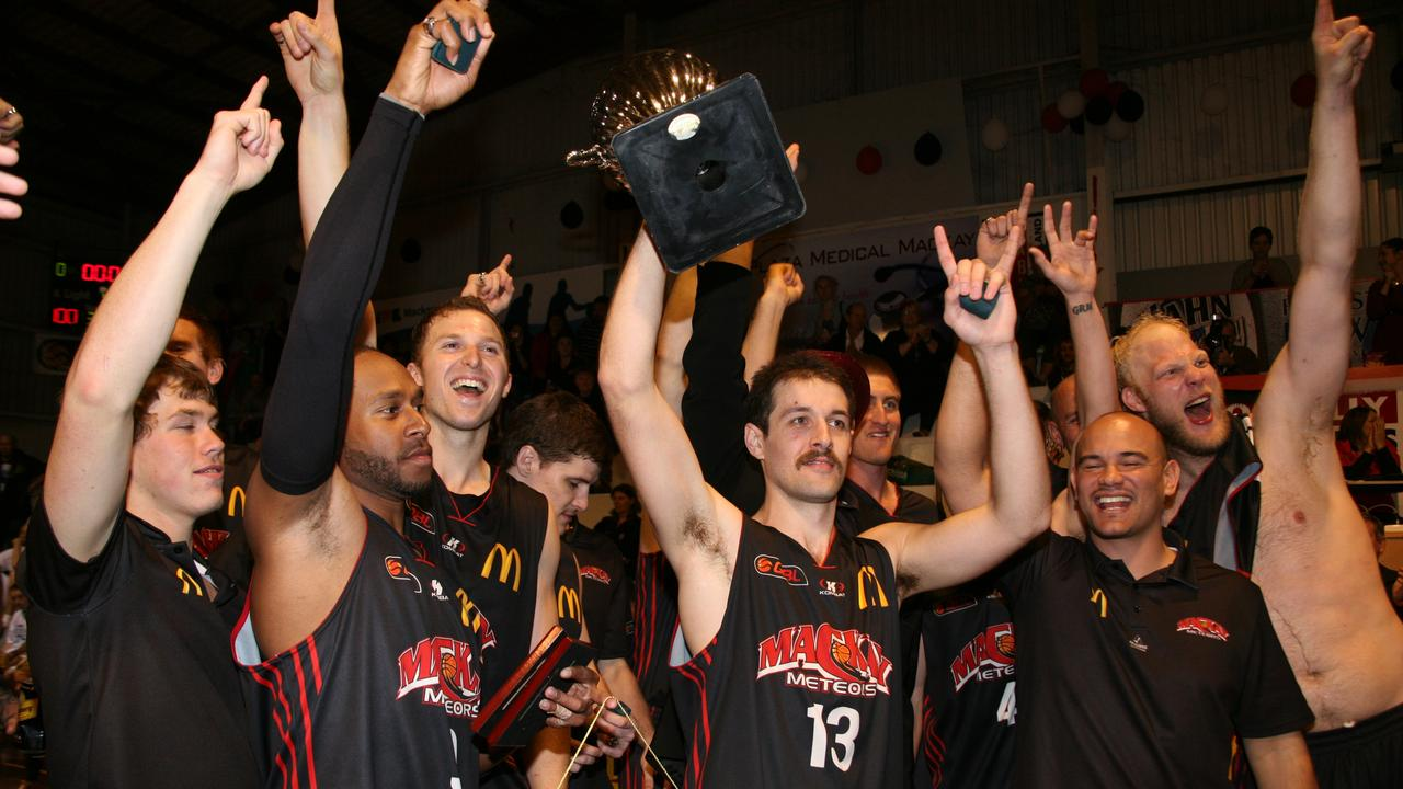 Mackay Meteors 2011 captain Rhys Martin celebrates winning the QBL grand final against Rockhampton Rockets. Photo: Lee Constable