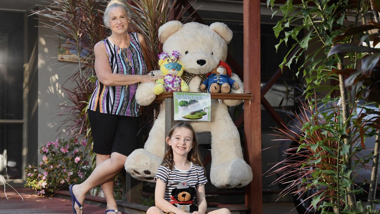 BEAR HUNTING: Jen Somerville and her neighbour Siena MacDonald, 9, with some of the teddy bears on show. Photo: Warren Lynam