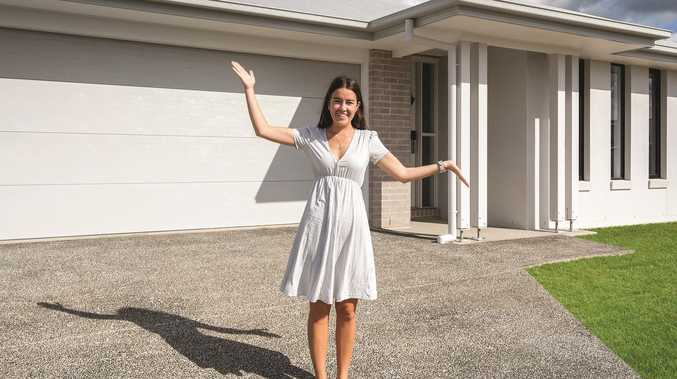 Young woman 'over the moon' with house deposit win