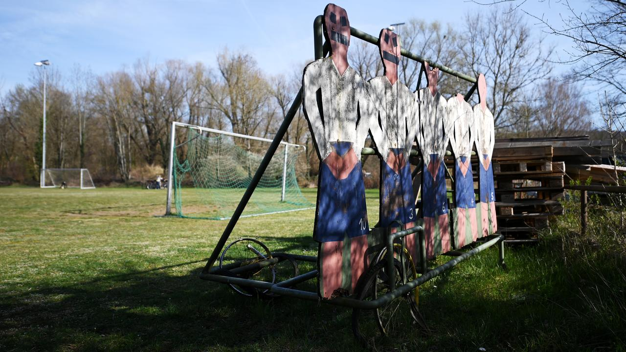An old fashioned defensive training wall at an empty football ground in Karlsruhe, Germany.