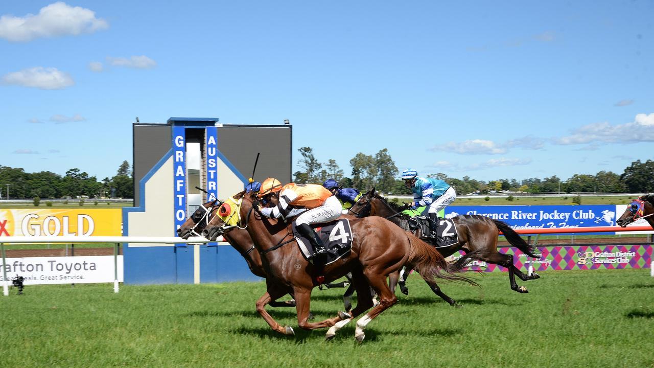 Matt McGuren starts the day racing at the Clarence River Jocky Club with a win on Matt Dunn-trained Bullet Shot in a photo finish with Ethan Ensby's Lady Grande in the Exclusive Trophies Benchmark 66 Handicap (2220 Metres). Photo: Bruce Thomas