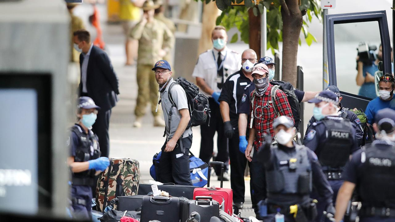 Paul Ashenden (left) and Brad Fleet pictured arriving at the Four Points Hotel after being charted from Nepal to the Brisbane International Airport. (AAP Image/Josh Woning)