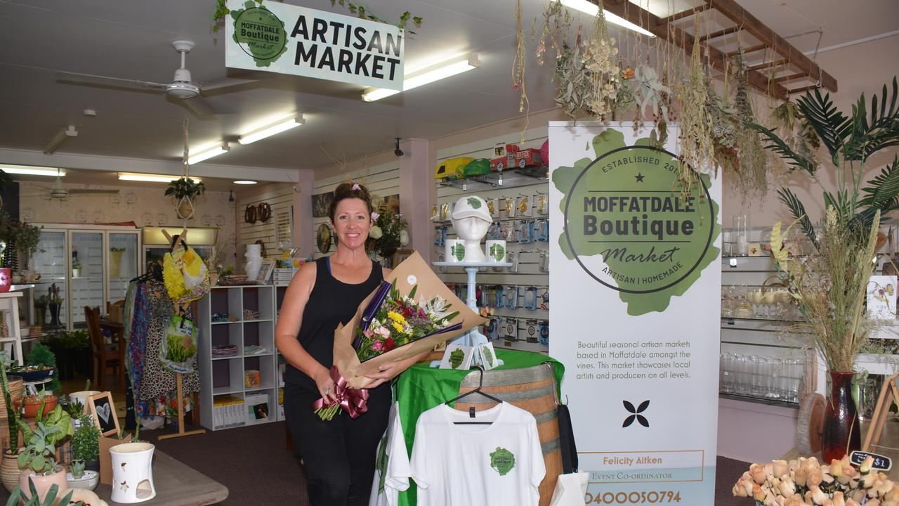 "INTO HER OWN HANDS: Despite the shop doors being closed and the markets being cancelled, Felicity Aitken from The Murgon Florist and Moffatdale Boutique Market says both the florist shop and markets are ""open"" for business …"