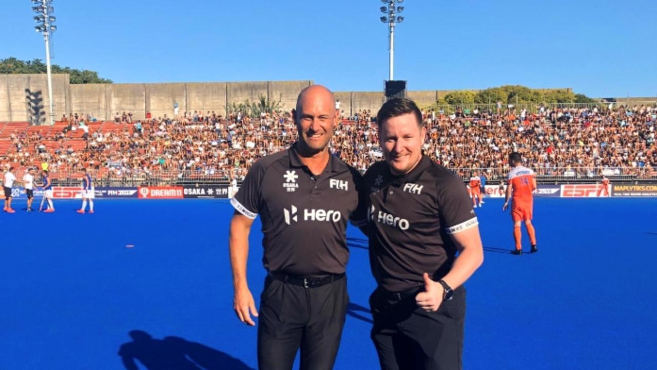 Ipswich international hockey umpire Steve Rogers (left) with Prague official Jakub Mejzlik during recent Pro League matches.