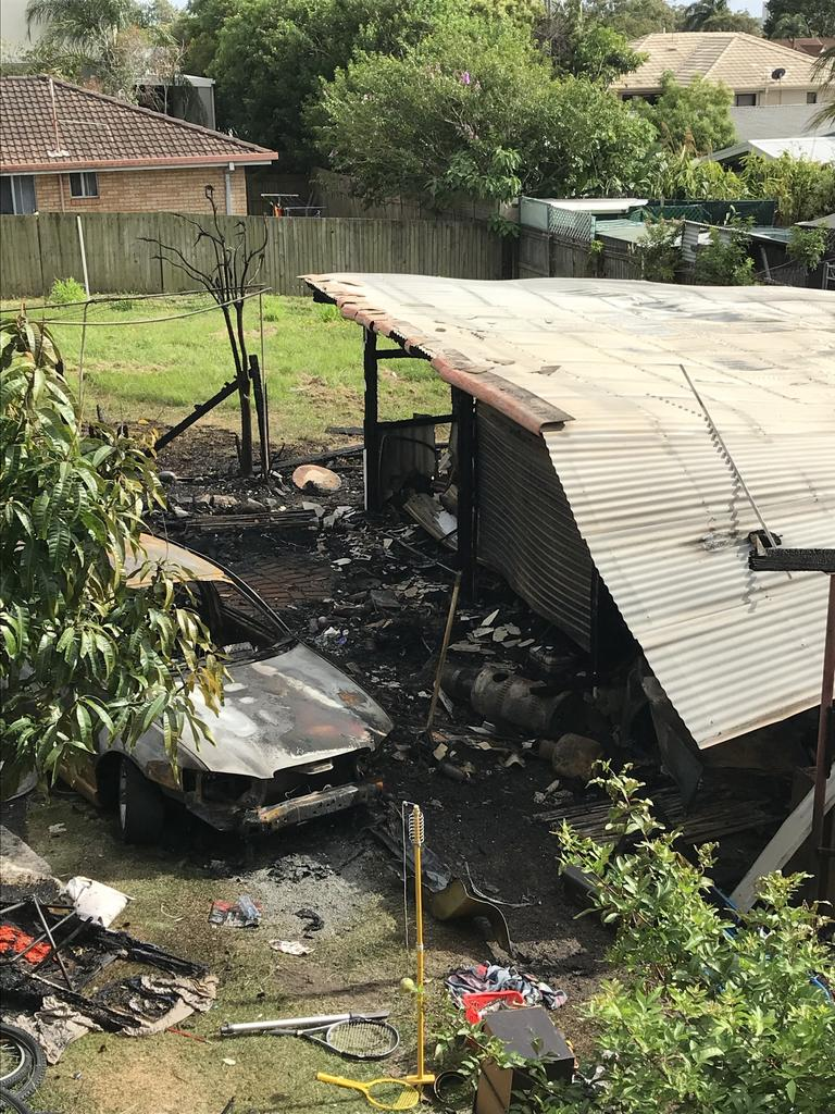 A burnt out car beside the shed. Photo: Emily Halloran.