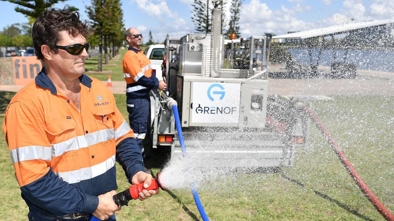 Grenof worker Simon Bayley sprays his company's ozone coronavirus disenfectant system. Photo: Patrick Woods