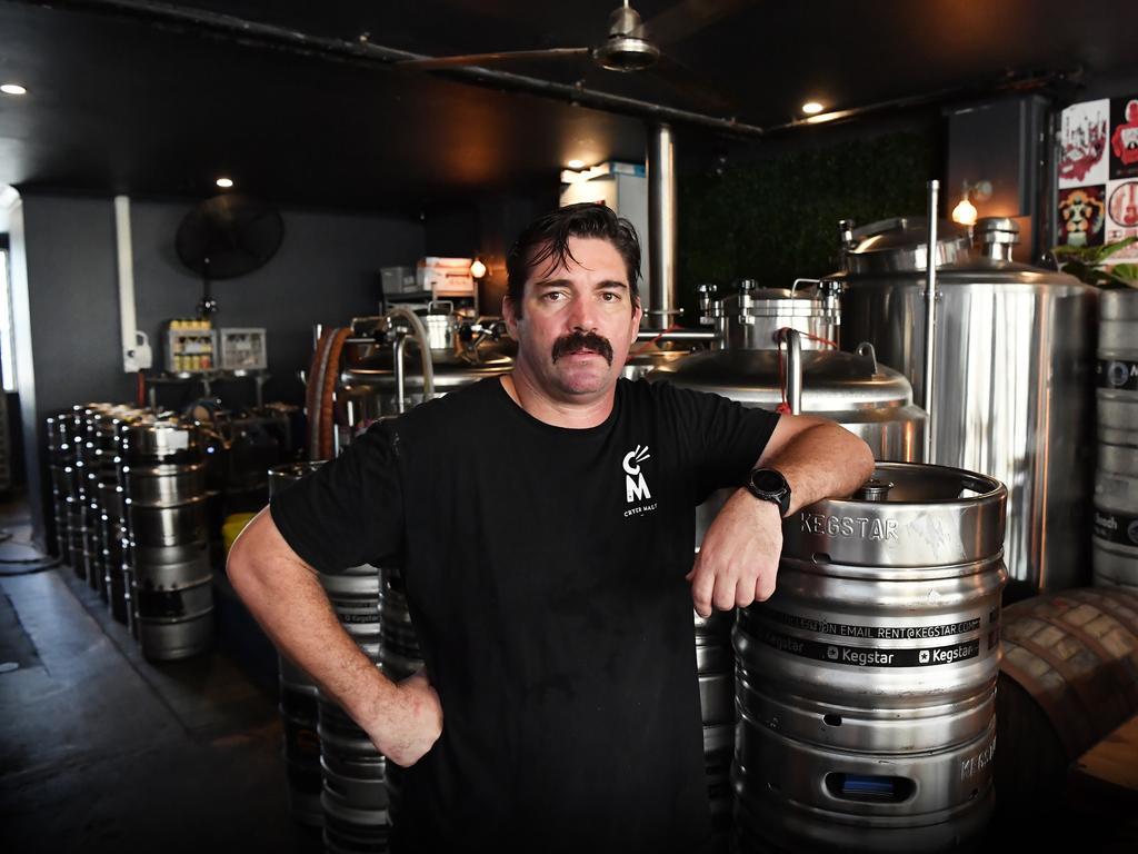 Matt Wilson, owner of Moffat Beach brewing Co have thousands of litres of beer that could be used in growlers' that they cant sell due to coronavirus restrictions. Photo Patrick Woods