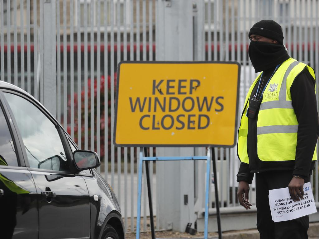 National Health Service staff wait in their cars to take a coronavirus test at a drive through centre in north London. Picture: AP