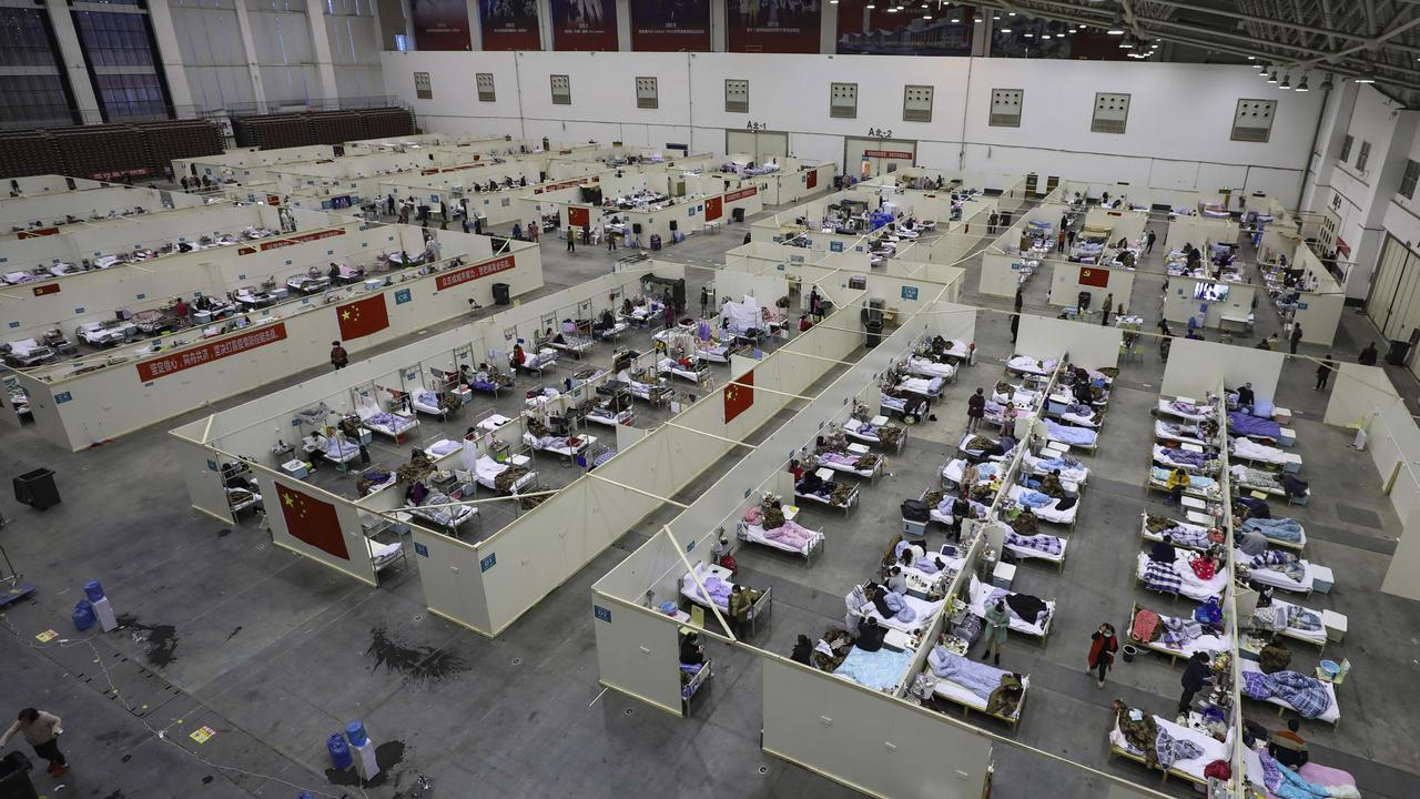 One of the temporary hospitals in a converted exhibition centre in Wuhan in February. Picture: Chinatopix via AP
