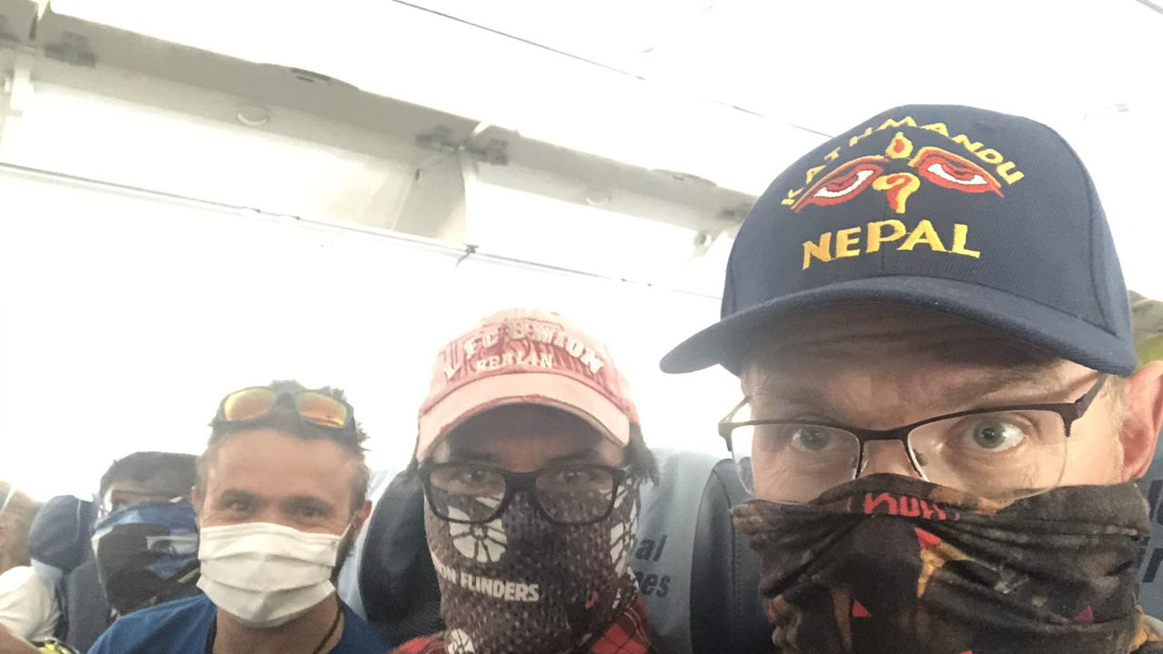 News Corp's personal finance editor Anthony Keane on the left pictured with Brad Fleet (middle) and Paul Ashenden on the right on their flight home to Australia from Nepal. The Australians had been stuck in Nepal since COVID-19 shut the country down Picture Supplied