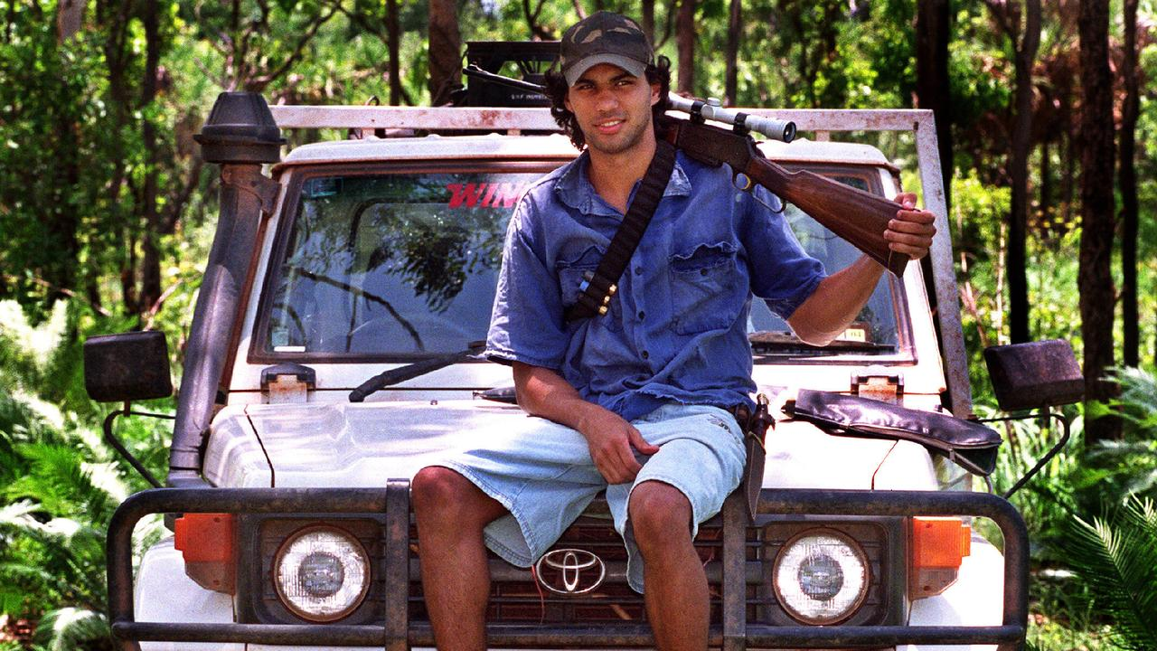 BACK IN THE HUNT: Footballer Raphael Clarke during a feral pig shooting expedition which will now be legal again for professionals.