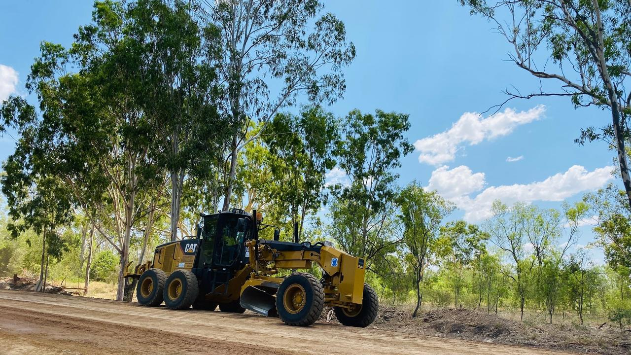 Rockhampton Regional Council machine at work at Thirsty Creek with road upgrade work being carried out as part of the Rookwood Weir project.
