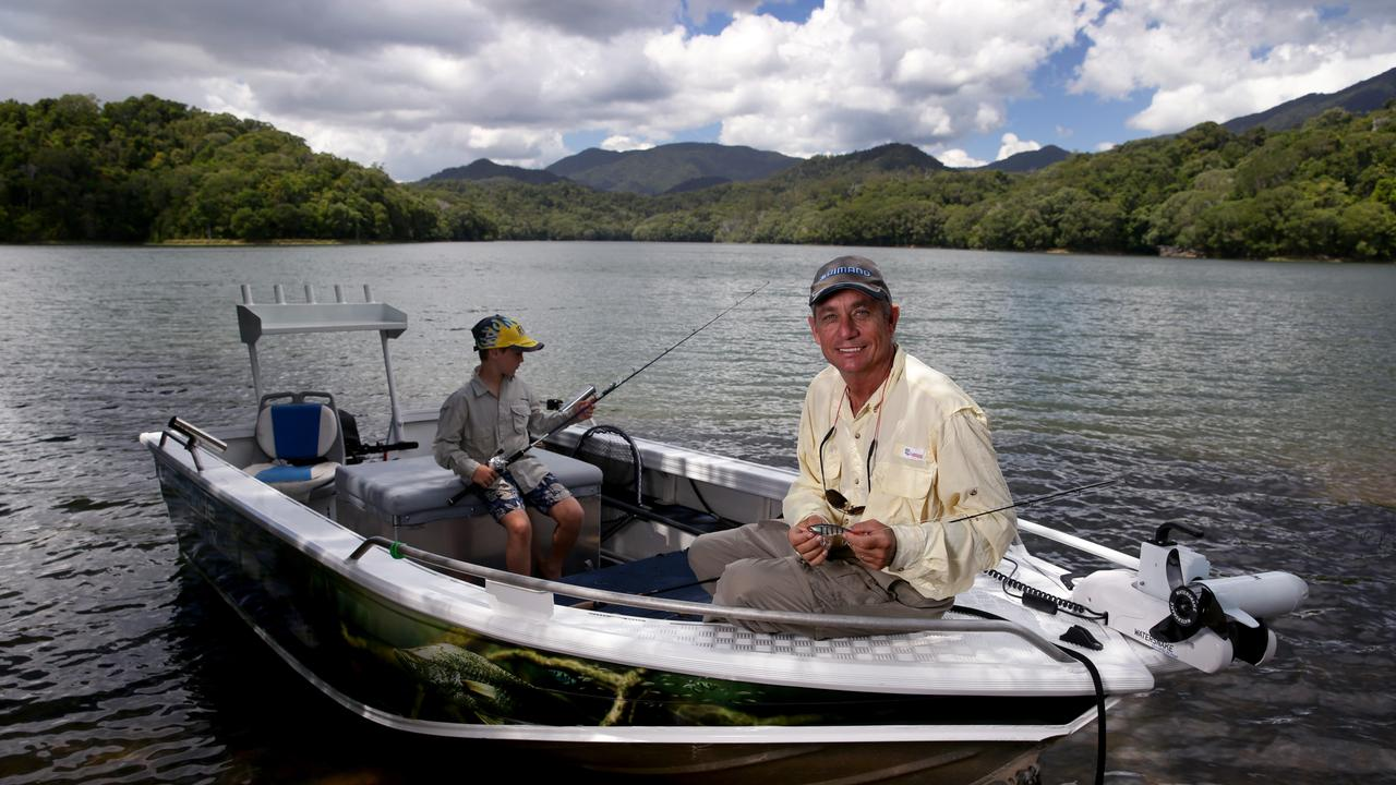 Kim Andersen's business Copperlode Fish and Kayak has been shut down by the coronavirus pandemic. But he can still get out on the water with his 10-year-old Cooper Luce. Picture: Marc McCormack