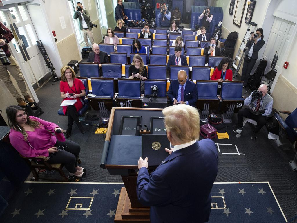 Journalists keep their distance in the James Brady Press Briefing Room at the White House, in Washington, as the US President gives his address. Picture: AP