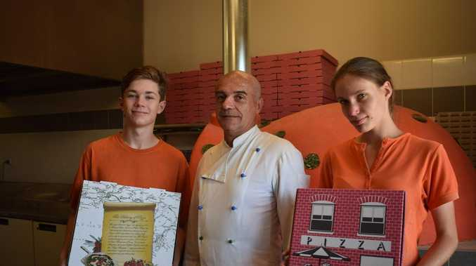 Business owner sells discounted pizzas to help workers