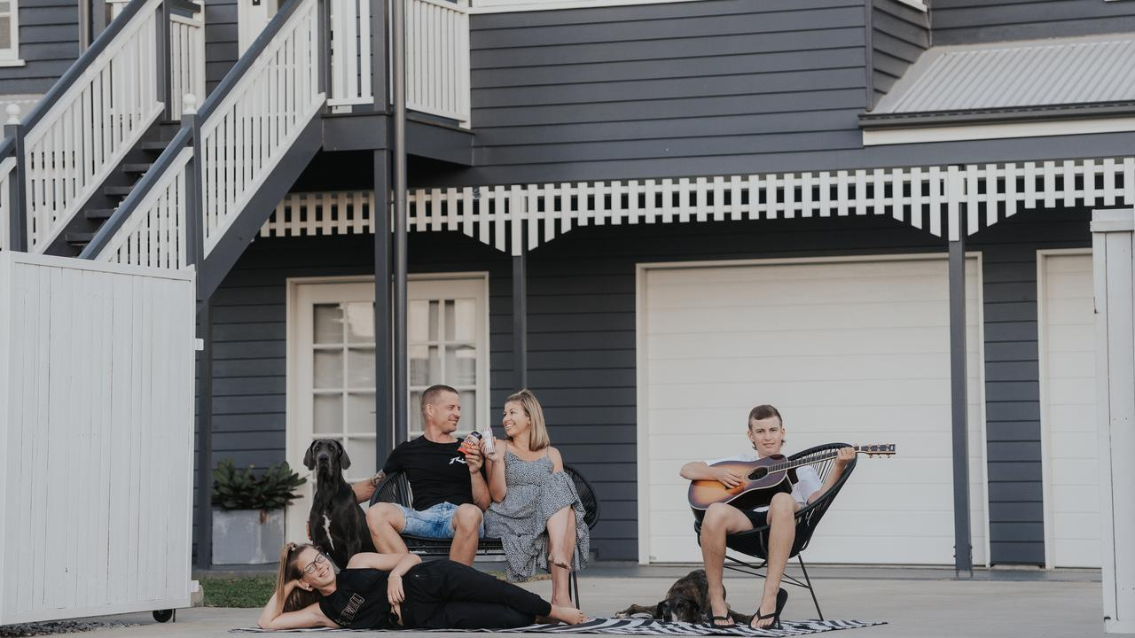The family of Michael Sleeman, Danielle Sleeman, Jordan Sleeman and Ella Sleeman with their dogs Stormi (sitting) and Roxy (lying down) – captured as part of the global movement #thedrivewayproject. Picture: Deanne Woods Photography.