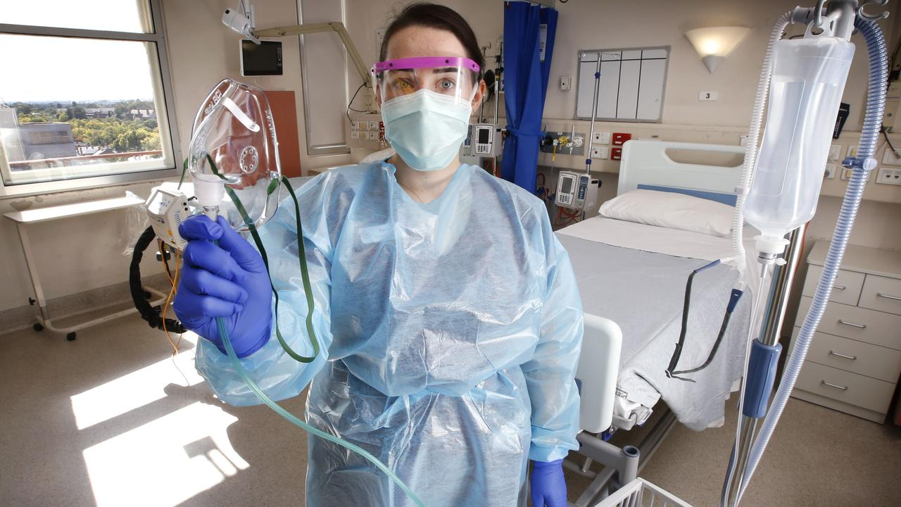 Infectious diseases nurse Karlee Robson wears a face mask at the Royal Melbourne Hospital. Picture: David Caird