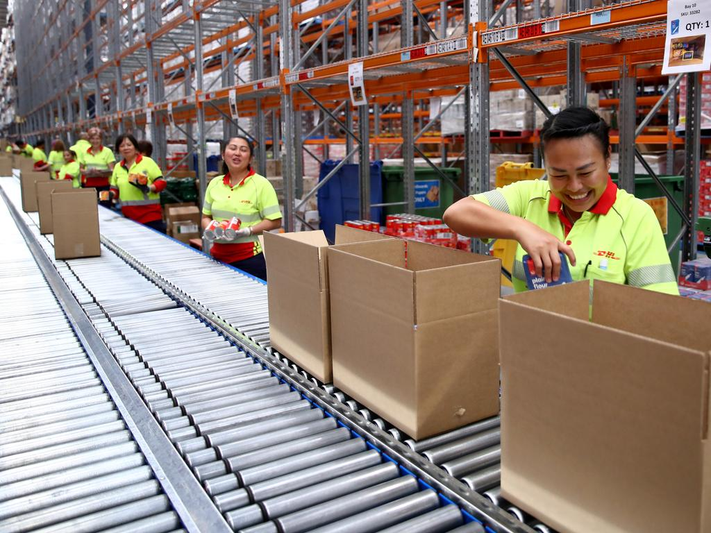 Woolworths has teamed up with Australia Post and DHL who will pack and send the boxes direct to those in need. Picture: Toby Zerna